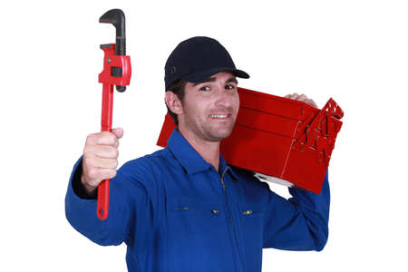 Worker with a toolbox and wrench photo