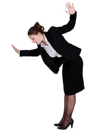 Businesswoman walking imaginary tight rope photo
