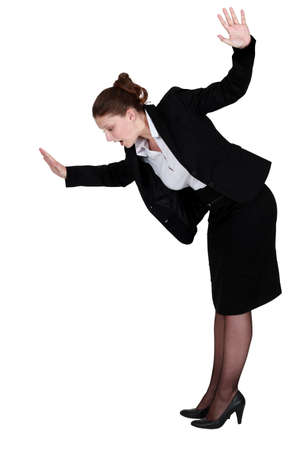 risky: Businesswoman walking imaginary tight rope