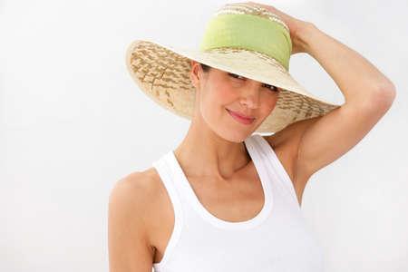 Brunette wearing straw hat photo