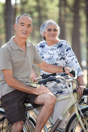 Old couple with bikes photo