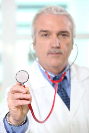 Doctor holding a stethoscope photo