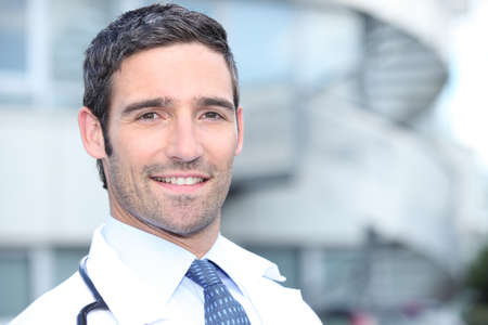 Doctor standing outside the hospital building Stock Photo - 11913476