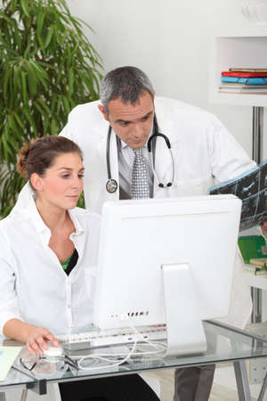 doctor and nurse discussing a case photo