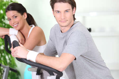 hometrainer: Couple using running machines Stock Photo
