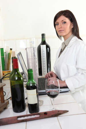 Oenologist analysing a wine Stock Photo - 11913583