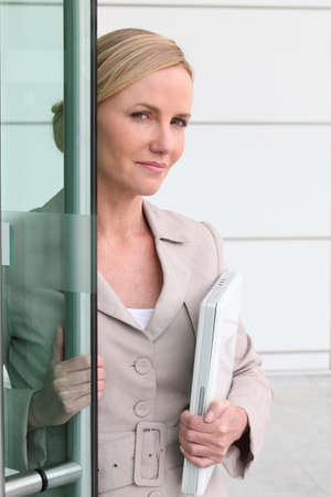 Blonde woman with a laptop in her arms photo