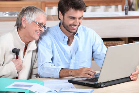 Happy doing accounting at home Stock Photo - 11913639