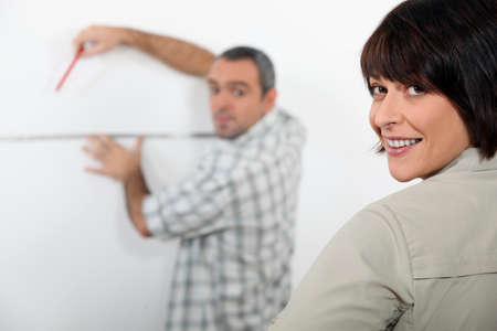 couple planning improvements in their apartment photo