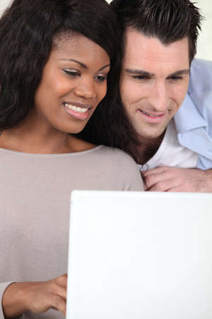 Couple watching video on laptop photo