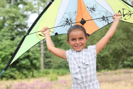 Girl flying her kite photo