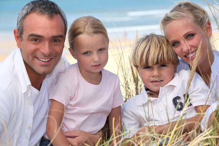Young family in the sand dunes photo