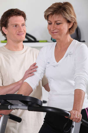 Personal trainer working with his client photo