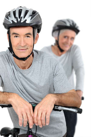 Elderly couple cycling photo