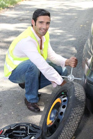 puncture: Changing the wheel on a car Stock Photo