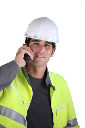 talkie: Foreman using radio receiver