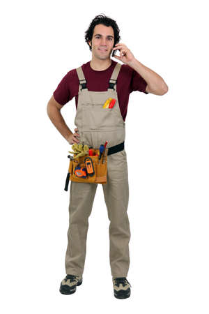 call out: Repairman talking on a cellphone Stock Photo