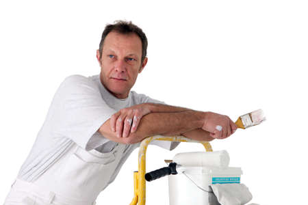 Painter resting on a stepladder photo