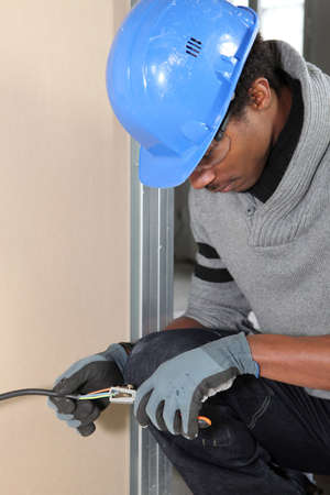 Electrician repairing electrical wires photo