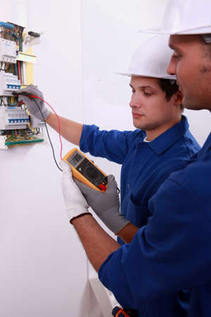 Electricians using multimeter photo
