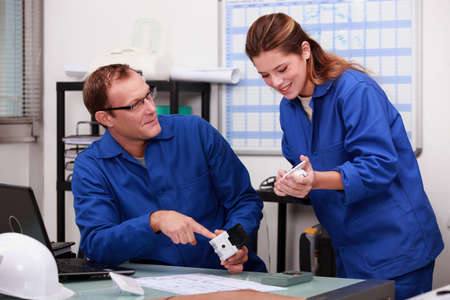 Plumber and female apprentice in office Stock Photo - 11935081