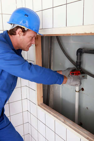 Plumber tightening a pipe Stock Photo - 11935025