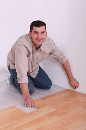 35 years old handyman laying parquet photo