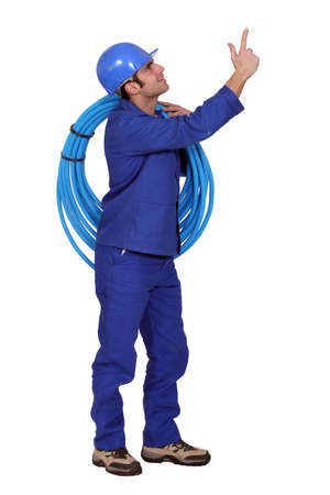 maintenance fitter: Man carrying coil