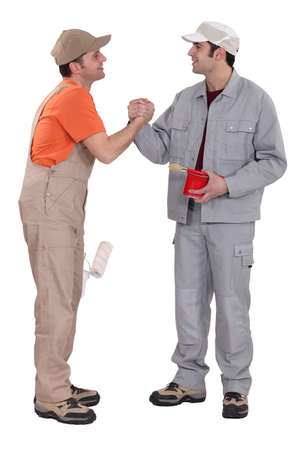 two craftsman painters shaking hands photo