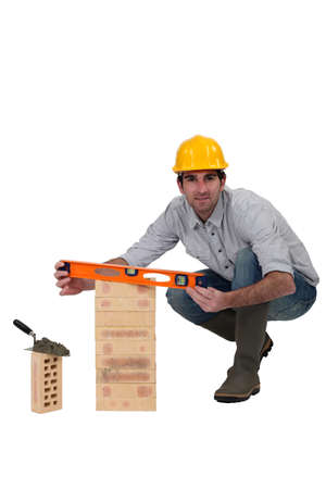 Bricklayer with a spirit level Stock Photo - 11928883