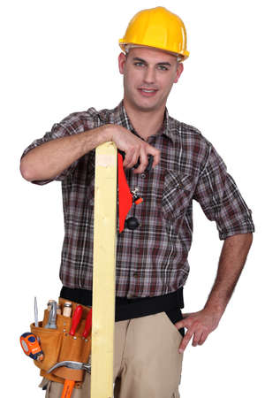 craftsman holding a wooden board photo