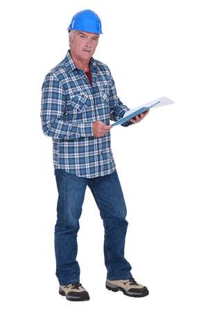 Senior architect reading through document photo