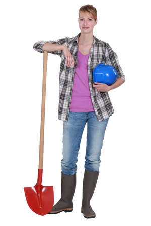 work boots: Potrait of a tradeswoman with her shovel