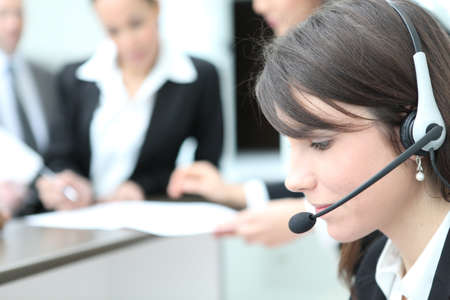 helpdesk: Young receptionist with headset