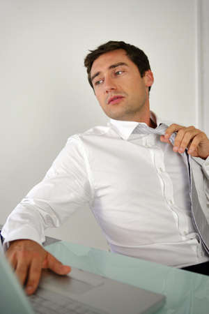 businessman taking off his tie Stock Photo - 11934967
