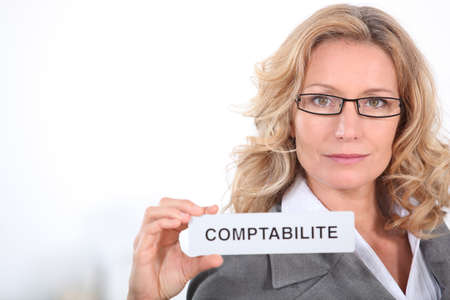 50 to 55 years: Comptabilite in french that means accounting Stock Photo