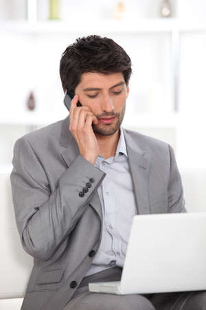ordinate: Dark haired man working from home Stock Photo