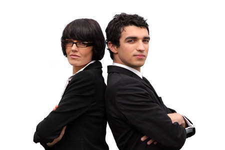 businesspartners: Businesspartners stood back to back Stock Photo
