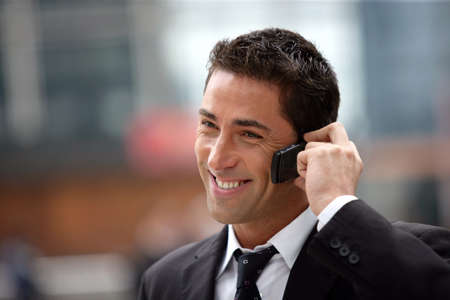 handsome businessman having phone call photo