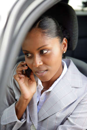 saleswoman: Businesswoman making a call from her car