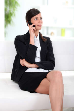 Business on cellphone in lobby Stock Photo - 11934975