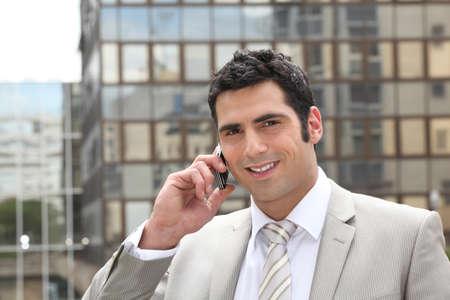 only man: Businessman using a cellphone