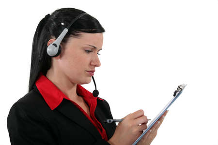Office assistant writing on a clipboard photo