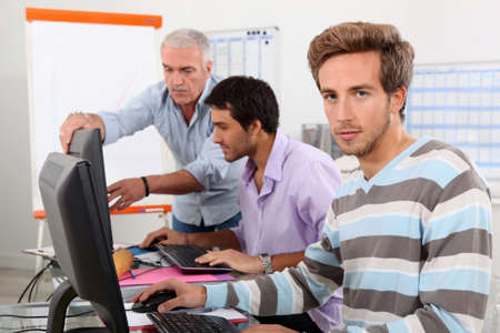 Men working on computers Stock Photo - 11935042