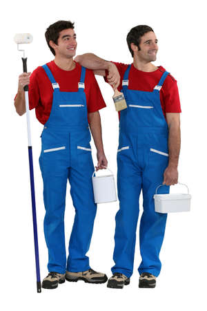 painters standing on white background photo