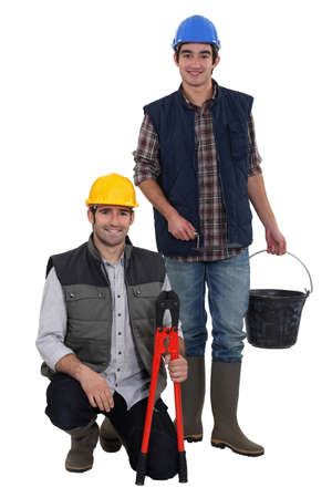 Two manual workers collaborating Stock Photo - 11934848