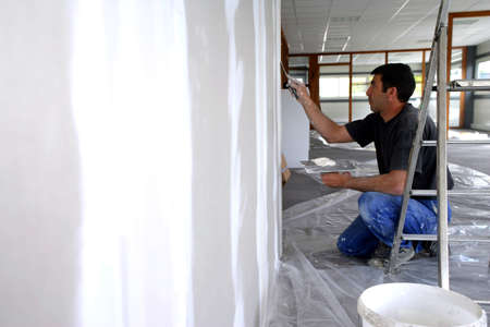 Man plastering a wall photo