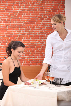 Waitress serving a meal photo