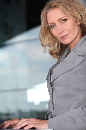 Businesswoman on laptop photo
