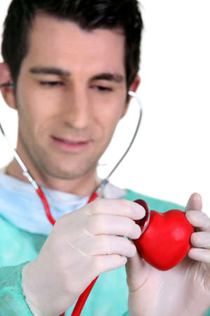 Doctor listening to the heartbeat of a heart photo